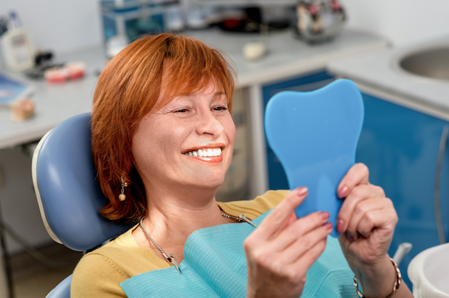 Happy patient with dental implants